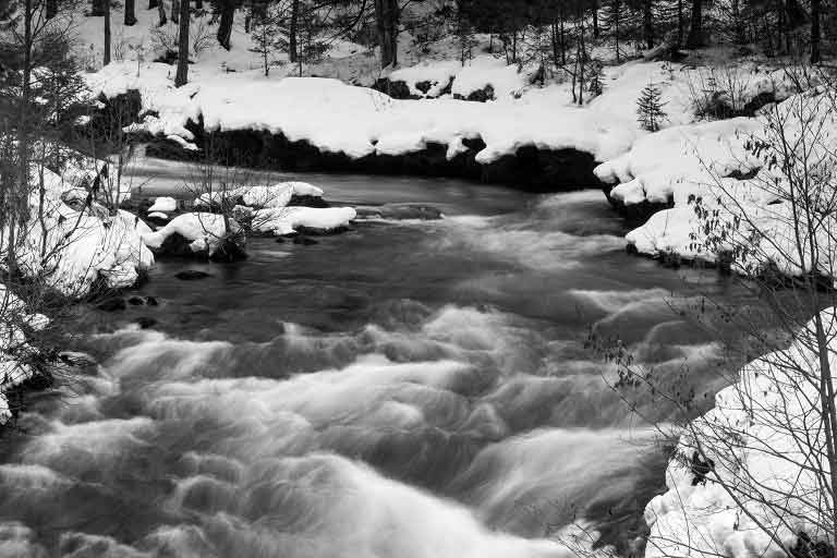 Snow filled river in Bend