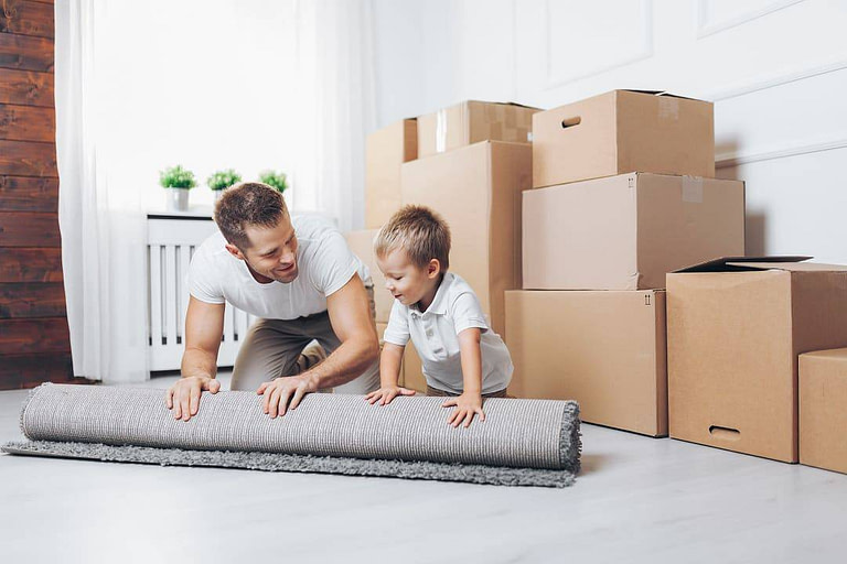 Man Playing With Baby in new home