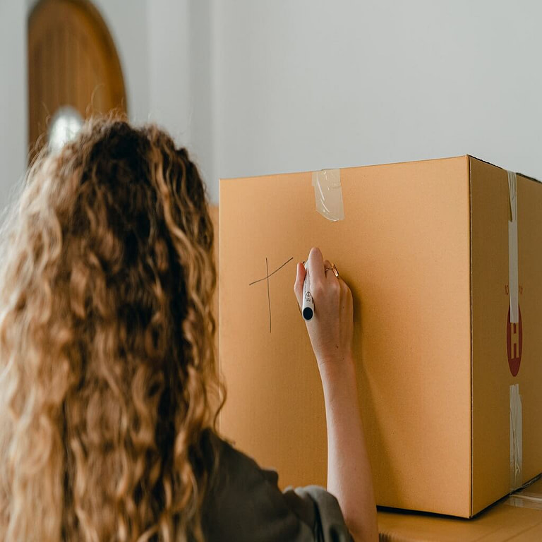 A girl is labeling into a box