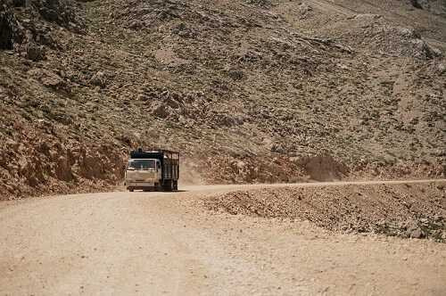 Moving truck in a mountain road