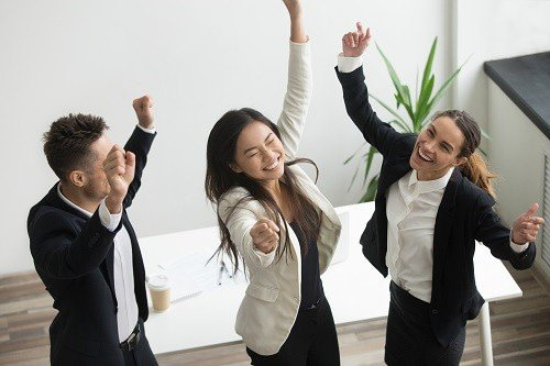 Employees cheering up after office relocation