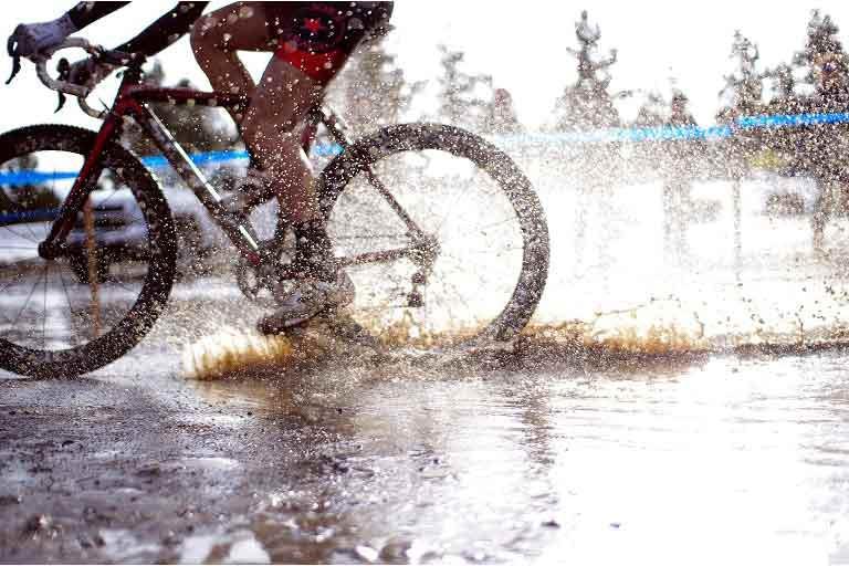 Bike racing in mud water