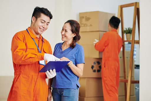 Smiling moving staff of MA removals company