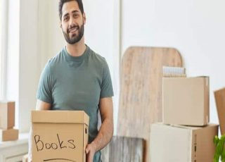 A Mover is packing goods for relocation